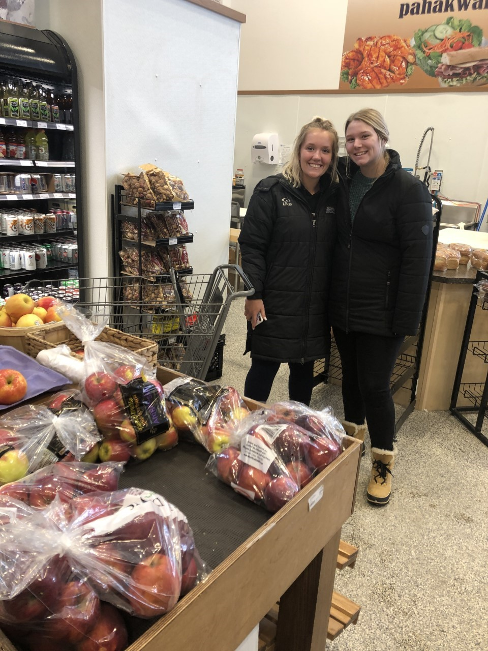 Education Students grocery shopping in Fort Chip- Left to Right Taylor Fraser-Chaba, Skylar Van Der Kooi
